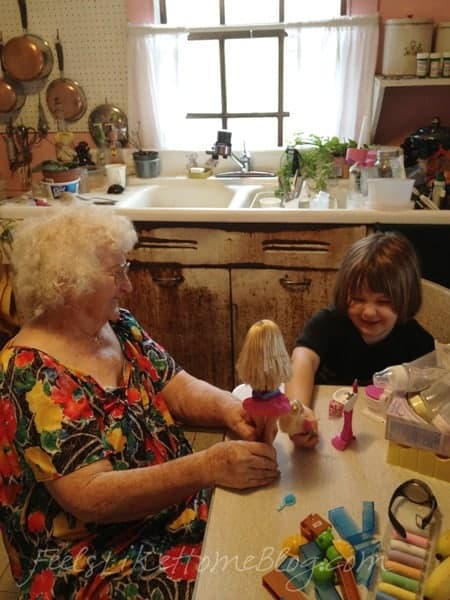 Old Grandma and Grace playing Barbies