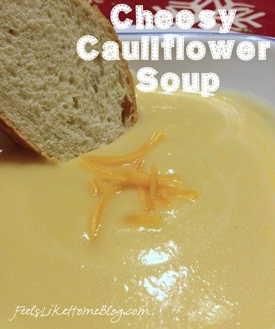 The best simple and easy cheesy cauliflower soup recipe - This low carb, gluten-free soup is healthy and under 200 calories a bowl. Quick and cheesy. Uses chicken broth but could be made vegetarian with vegetable stock instead.