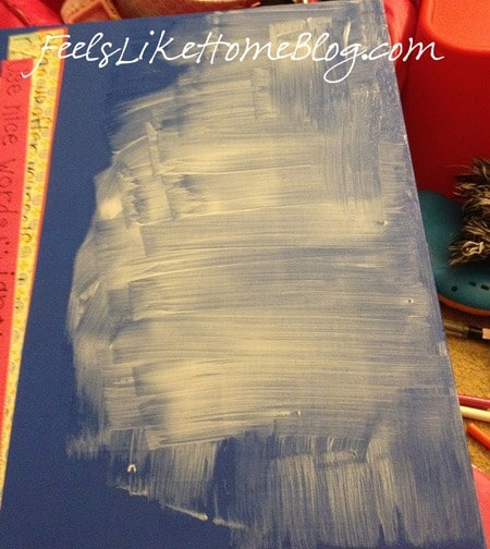 Paint Mod Podge on the canvas