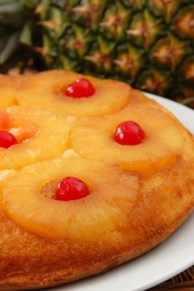 The best simple and easy pineapple upside down cake - This classic, old fashioned recipe starts with a cake mix from a box so it is very quick and very moist. Can use crushed, chunks, or rings of pineapple. Baked in the oven in a skillet, this makes a round cake. Originally a Pampered Chef recipe with brown sugar and butter topping.