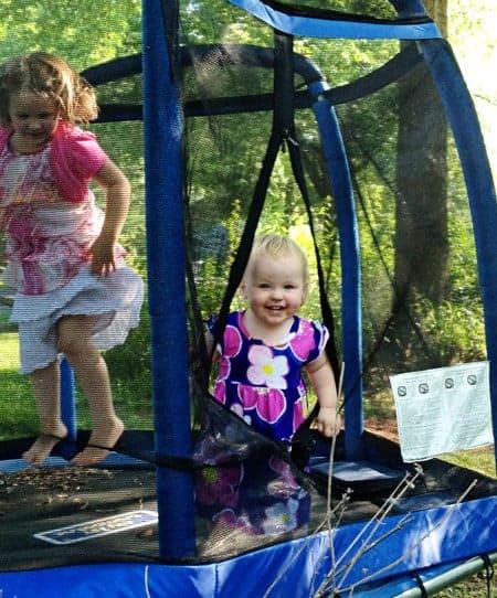 A little girl on a trampoline