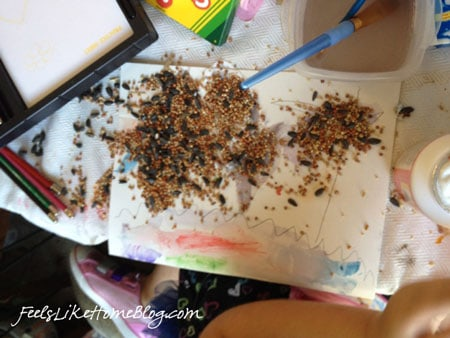 easy crafts for kids - This quick and easy (and messy) bird seed craft for kids is great for toddlers and preschoolers but would also work for older elementary kids. How to make an easy DIY craft that is fun. Great ideas for projects and activities. Includes tutorial.