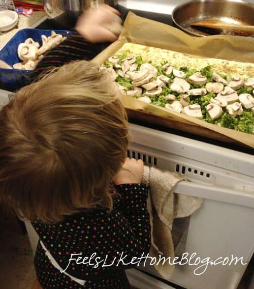 A little girl preparing an omelet