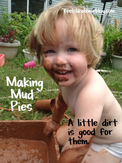 A little girl making mud pies