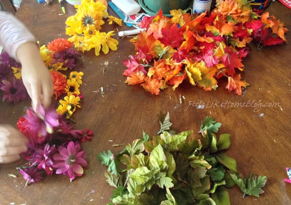 Separate silk flowers by color - Autumn Wreath Craft for Kids