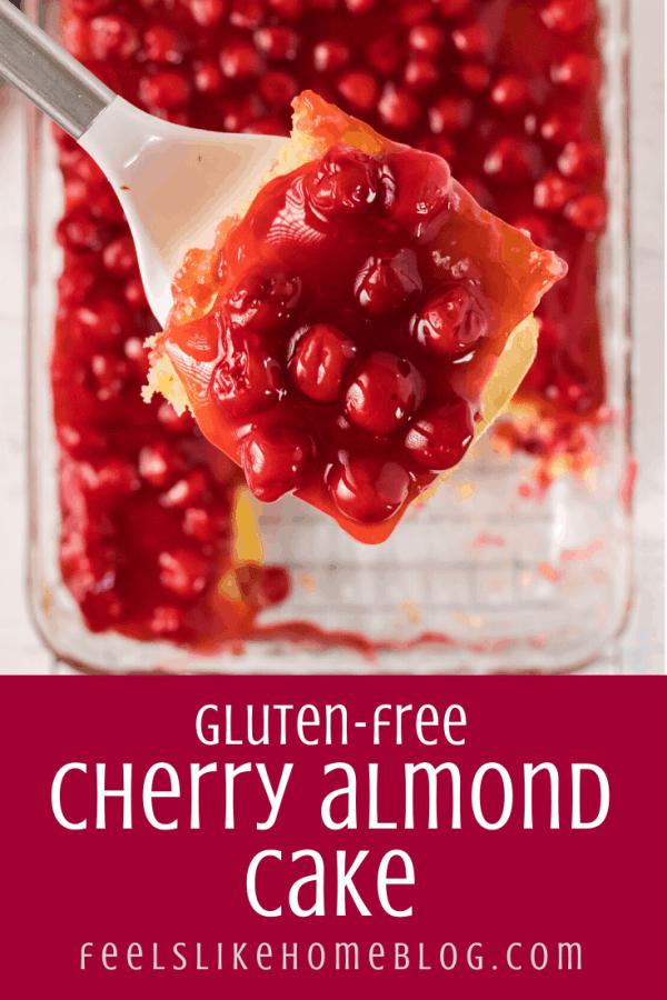 A close up of cherry almond cake on a spatula
