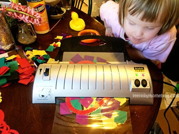 Laminating the suncatcher - Easy Valentine Suncatcher Crafts for Kids