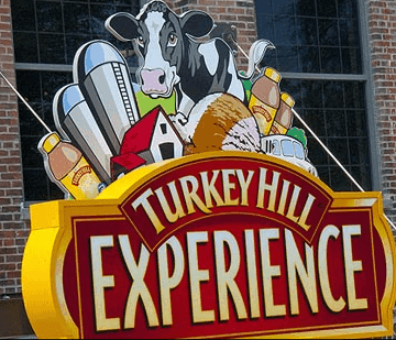 The Turkey Hill Experience sign on a brick building
