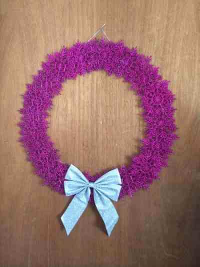 A wreath made of glittery purple snowflakes
