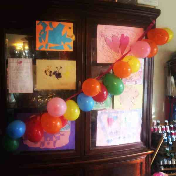 A string of balloons across a cabinet