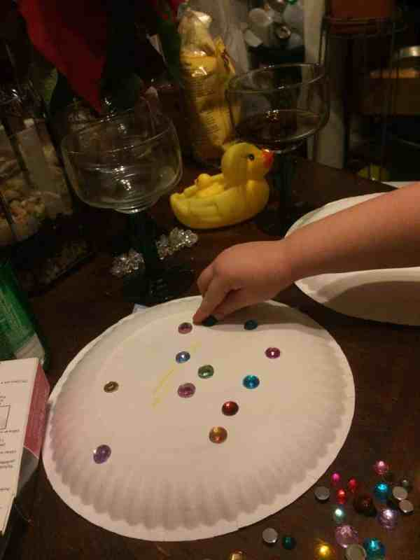 Glue sequins or jewels onto the paper plates