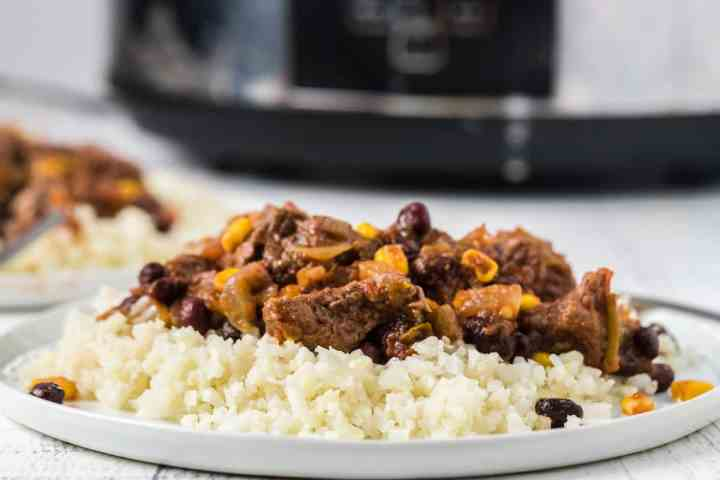 a plate of food in front of the slow cooker