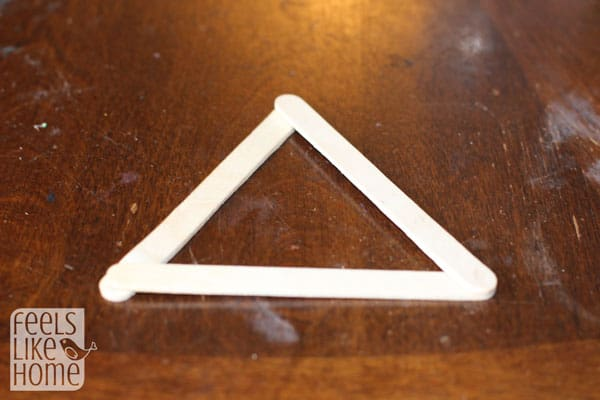 glue-a-triangle-popsicle-stick-christmas-tree-preschoolers