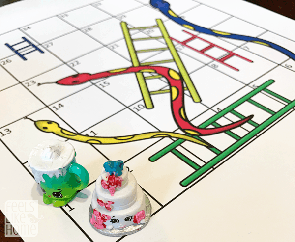 Free printable learning games for kids - This fun Snakes and Ladders game can be used a variety of ways for teaching reading skills, numbers, counting, and more. Best for preschool and elementary, but fun for adults and older kids, too!