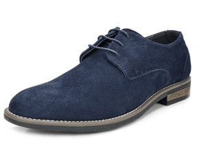 A pair of feet wearing blue shoes