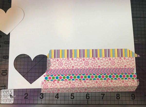 stick washi tape to a piece of paper in even rows