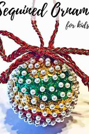 How to make DIY sequin and pin styrofoam ball Christmas tree ornaments for kids and adults - These simple & easy handmade ornaments make a pretty addition to any homemade Xmas tree. Awesome, fun craft for children, tweens, and teens. Picture shows stripes, but ideas for other decorations and patterns with loose sequins and lots of bling.