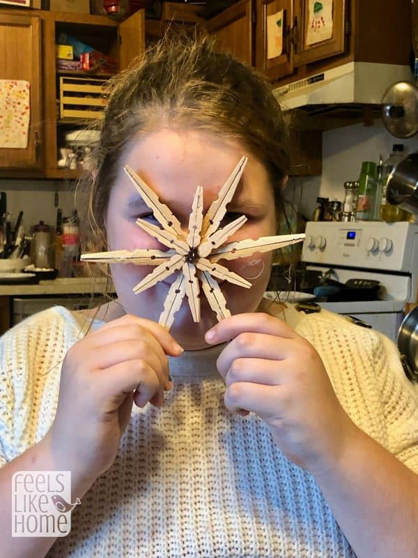 A person a clothespin snowflake