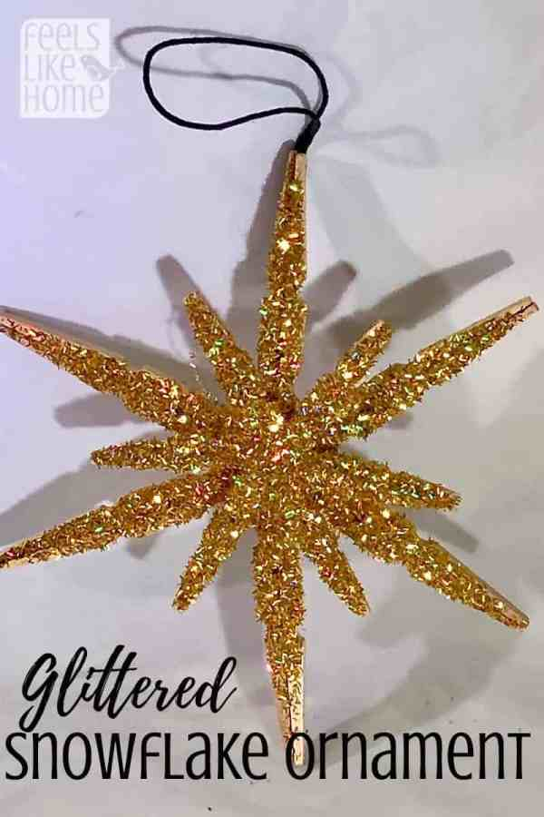 How to make simple & easy DIY rustic clothespin snowflake ornaments with mini and regular sized spring clothespins - Awesome & cute wooden snowflakes covered in gold glitter. For kids or adults.