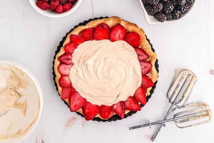 arrange fruit on top of tart filling