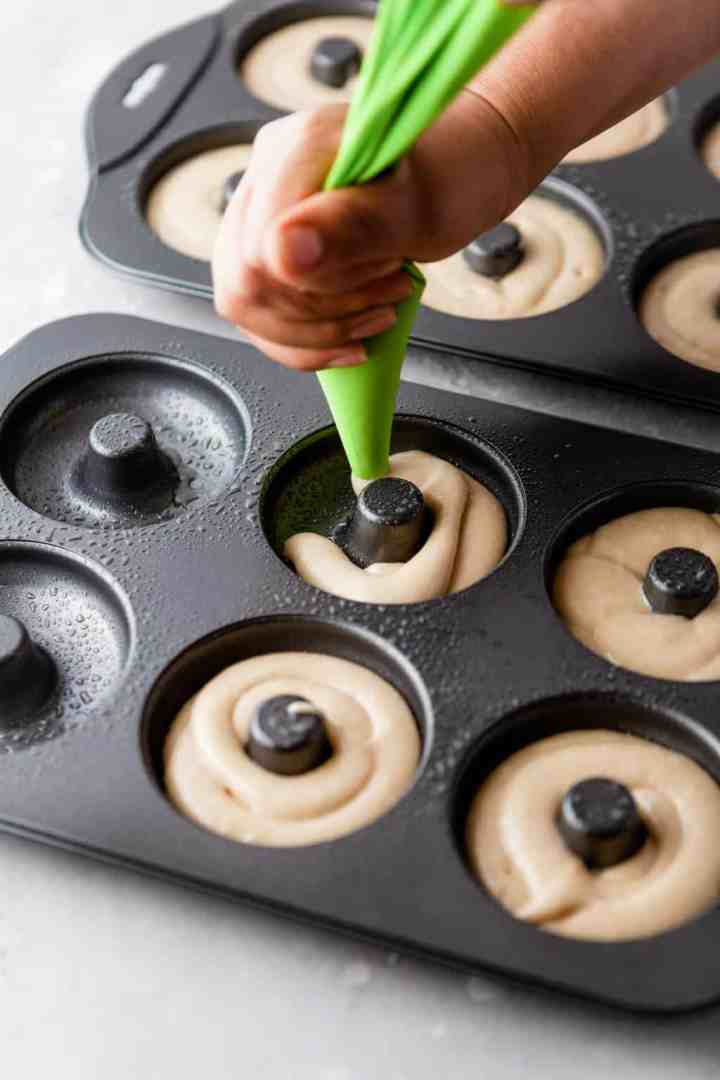 pipe the donut batter into the donut pan