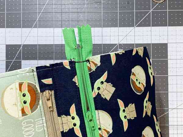 sew the zipper shut even with the edge of the fabric