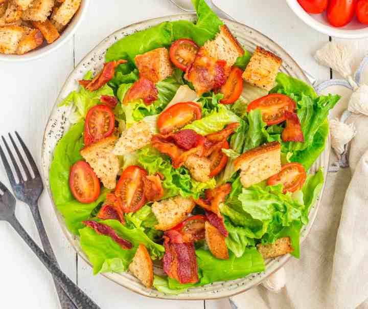 BLT salad assembled on a white plate