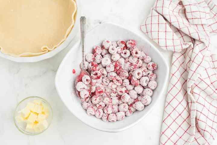 toss the berries in lemon juice and powder