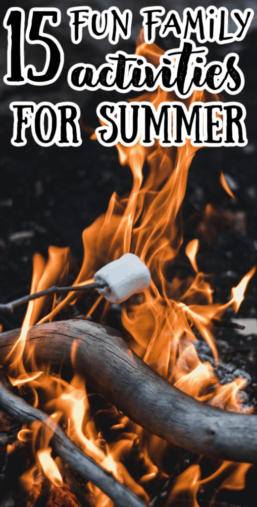 cooking s'mores over a campfire