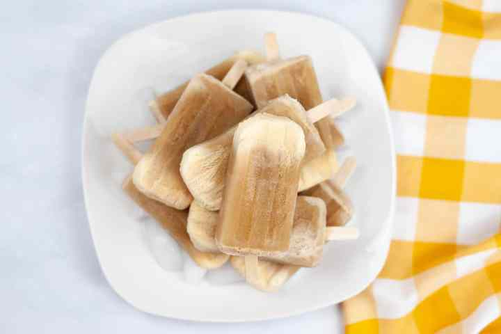 a pile of root beer float popsicles on a white plate