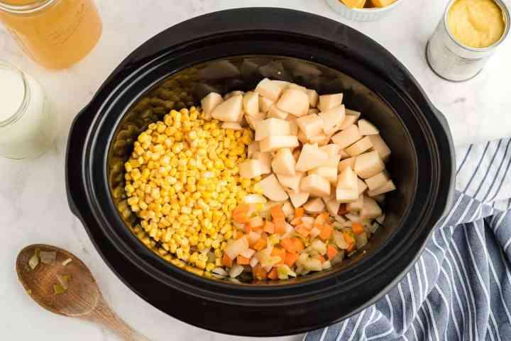 add potatoes and corn to the crockpot