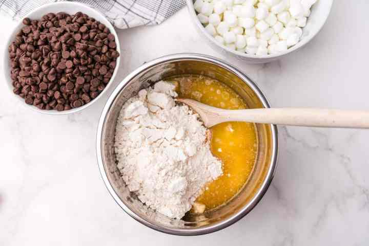 mix cookie mixture with melted butter
