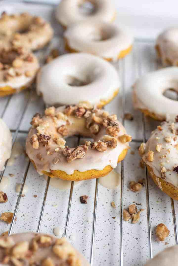 sprinkle glazed donuts with walnuts
