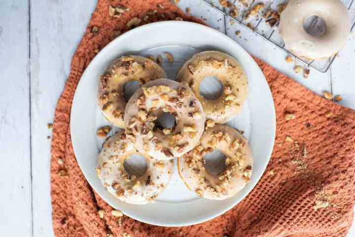 a plate of pumpkin spice donuts