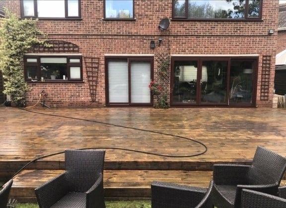 jet cleaning wooden decking in garden