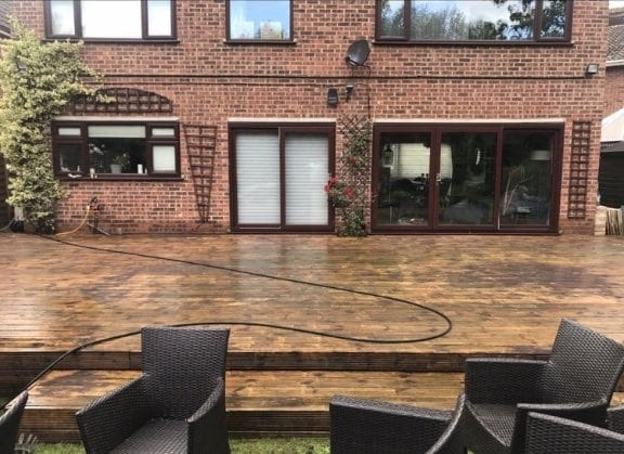 jet cleaning wooden decking in garden
