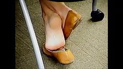 Cute Teen In College Playing With Her Sandals In Class