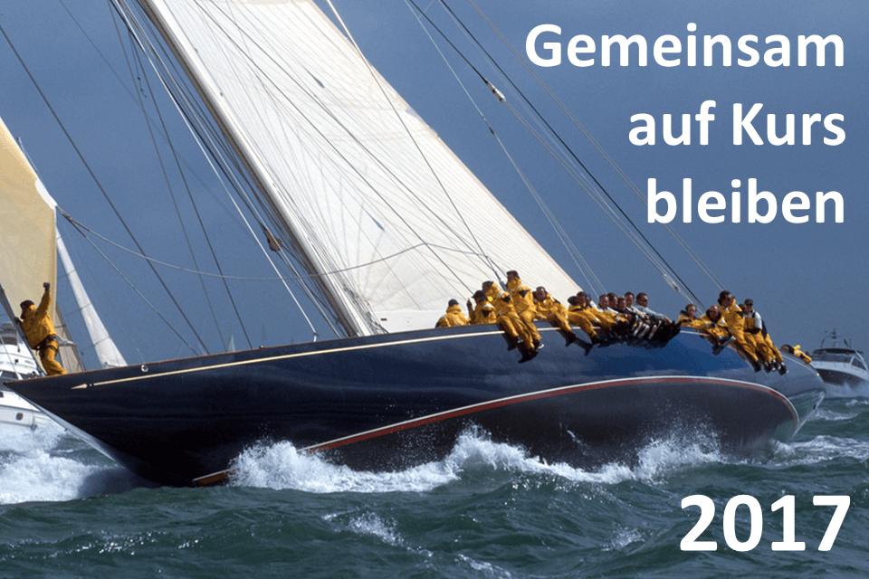 Gemeinsam auf Kurs bleiben 2017: Logo: Schiff in der Kurve, Besatzung am Bootsrand