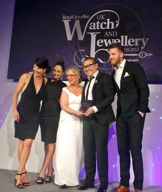 Fei collecting his award for 'Bridal Design of the Year'.