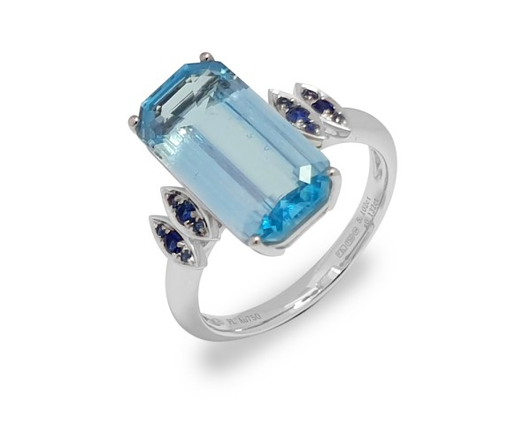 Fei Liu Victoriana emerald cut blue topaz with should set blue sapphires in 18ct yellow gold.