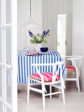 Ian Mankin: Tablecloth in Norfolk Stripe Indigo £24.50 per metre, Seat Covers in Oxford Stripe Peony £29.50 per metre, Napkins in Candy Stripe Peony and Indigo £19.50
