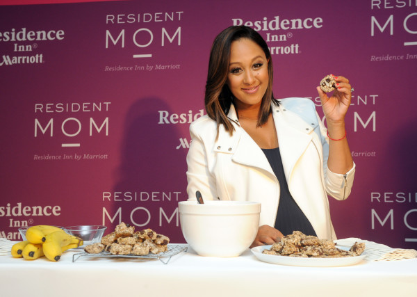 Tamera Mowry-Housley, Residence Inn's  2015 Mom of the Year, shares a healthy cookie recipe she created for Residence Inn, Tuesday, May 5, 2015, in New York. Residence Inn celebrates moms for all that they do and makes moms' lives easier on the road.  (Photo by Diane Bondareff/Invision for Residence Inn/AP Images)
