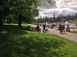 Leading our bikes through Hyde Park after lunch.