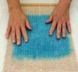 flatten the bubble wrap against the fibres