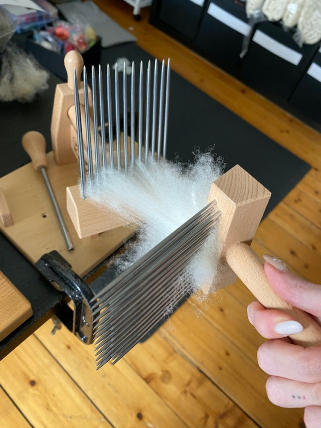 English wool combs processing wool on a table