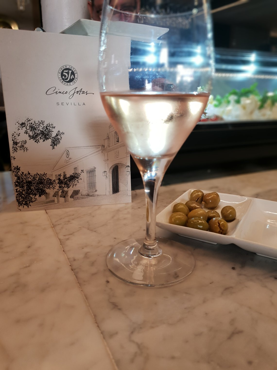 A glass of rosé wine in a tapas bar in Seville, Spain.