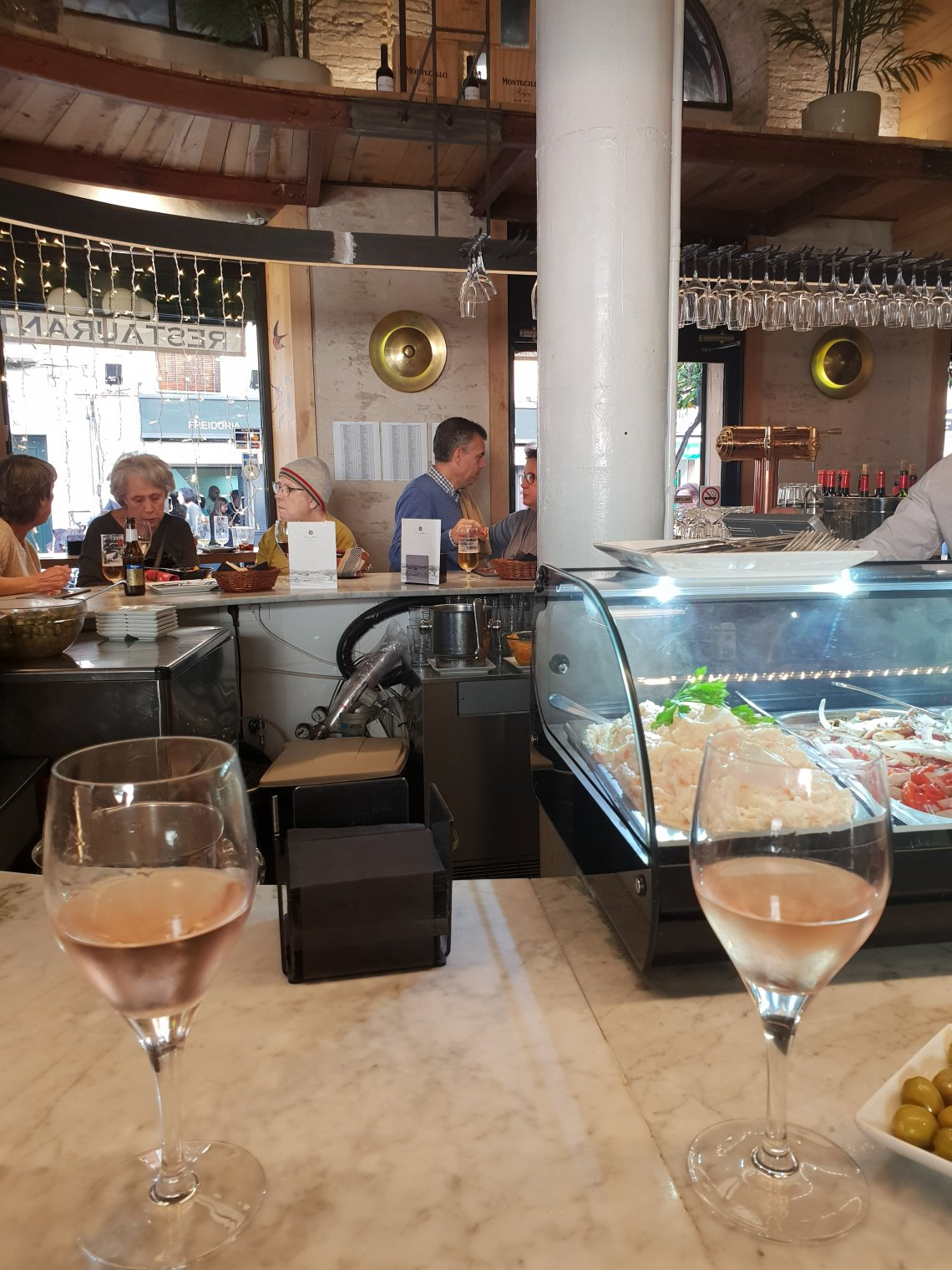 Two glasses of rosé wine in a tapas bar in Seville, Spain.