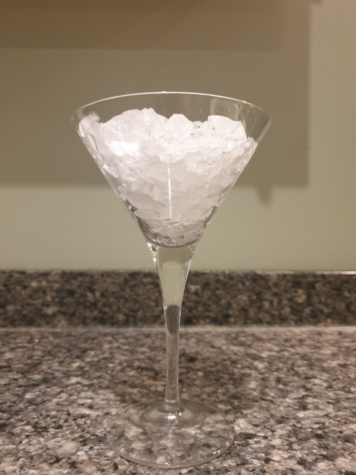whiskey sour - a cocktail glass filled with crushed ice
