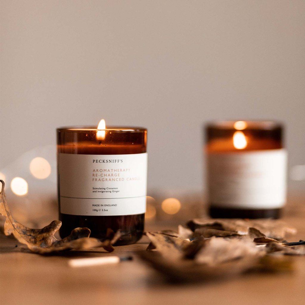 Two candles on a bed of autumn leaves.Autumn Playlist - Female Original