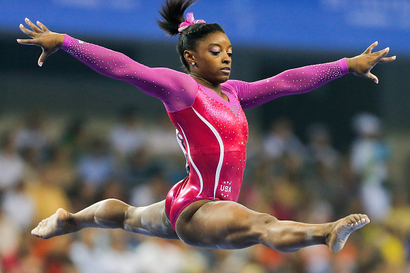 NANNING, CHINA - OCTOBER 10: Simone Biles of United States performs on the Balance Beam during the Women's All-Around Final in day four of the 45th Artistic Gymnastics World Championships at Guangxi Sports Center Stadium on October 10, 2014 in Nanning, China. (Photo by Lintao Zhang/Getty Images)